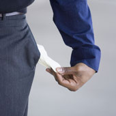 Man showing empty pockets