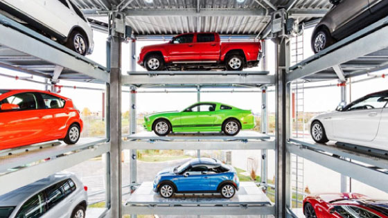 Colorful cars stacked in a display representing Carvana inventory ready to buy.