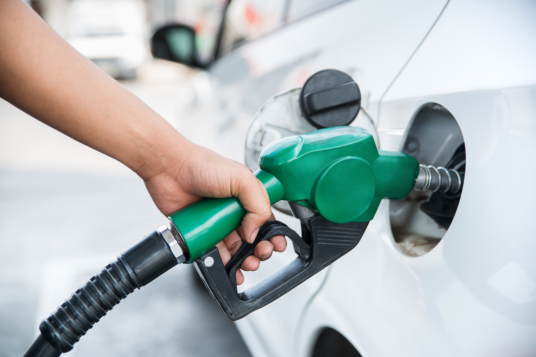 Close up of woman's hand using gas pump