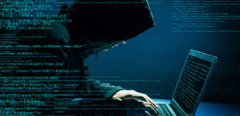 Hacker using computer to steal identities
