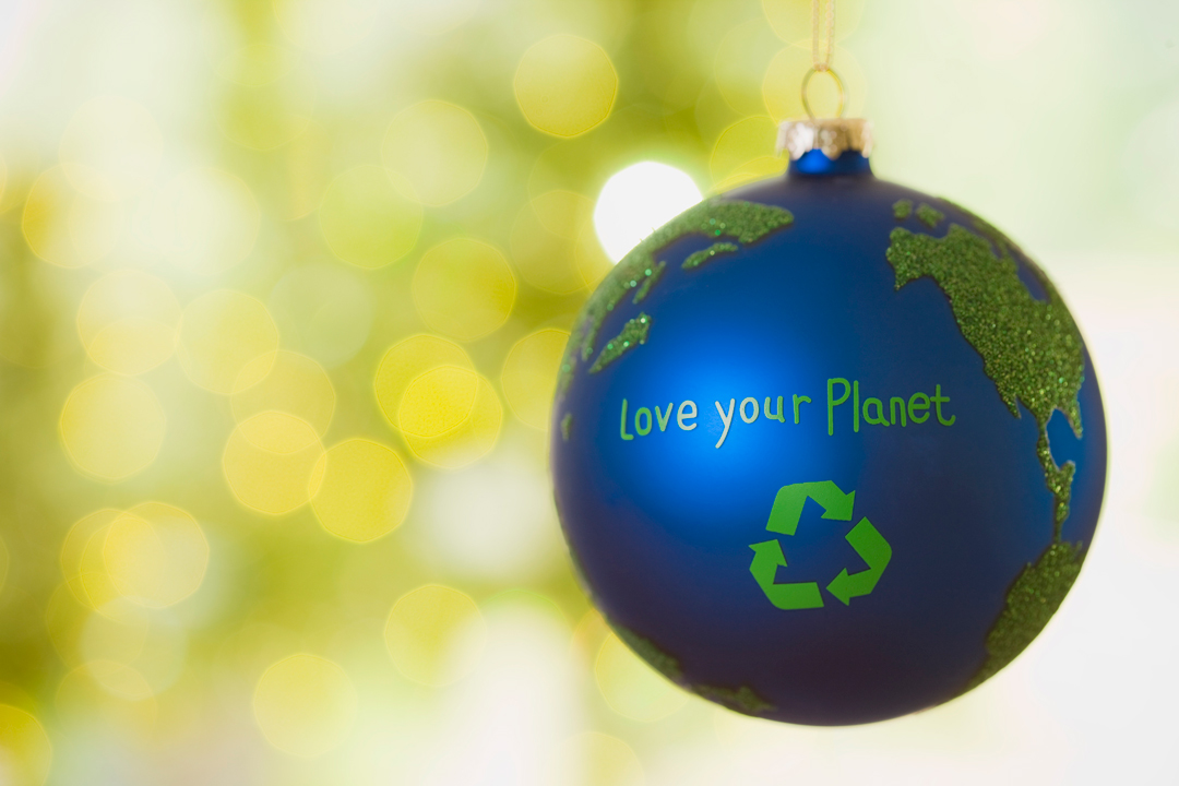 Close up of an ornament that looks like earth with the words Love Your Planet on it.