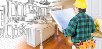 Real estate investor looking at blueprints and imaging the room finished after renovations