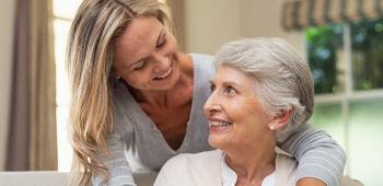 Adult female caring for older adult mother
