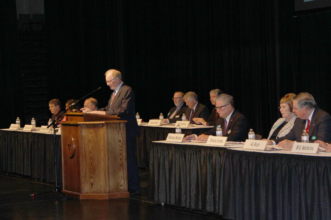Ten TFCU board members sitting at annual meeting