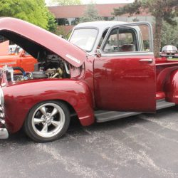 Deep red custom truck at the 2019 TFCU Miracle Car Show